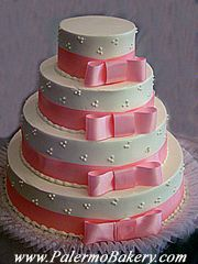 A tiered cake with ribbons and bows accentuating each level, is classy elegant and simple!