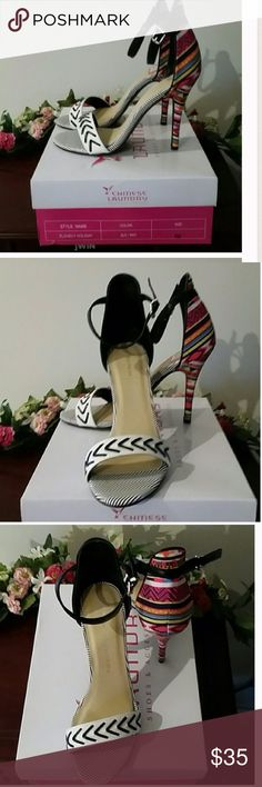 Chinese Laundry Heels New in Box! Brand new, never worn. Black and white design on front, multicolor design on back. Chinese Laundry Shoes