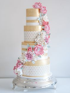 Gold wedding cake with hand made sugar cascading flowers