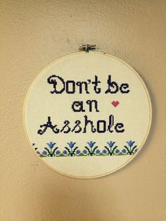 """ascendinglotustattoo-vancouver: """" Our piercer, Courtnie cross-stitched us our very own 'shop rules'. We all share this general motto. Don't be an Asshole by Courtnie Houde Ascending Lotus Tattoo in..."""