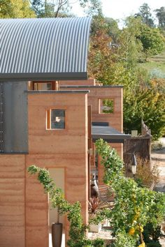 rammed earth construction with tin roof