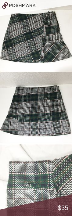 """CHICWISH PLAID MINI SKIRT Chicwish preppy Plaid mini skirt. Fringe trim. A-line. Faux wrap. Side zip closure. Care tags removed.  Waist: 14"""" Length: 15"""" *All measurements approximate hand measurements taken laid flat, double where necessary. chicwish Skirts"""