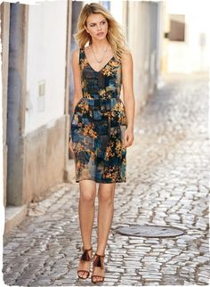 The ultimate party dress captivates in a painterly montage of florals and colorblocking. Tailored to perfection in drapy silk crepe with a double v-neck, defined waist seam, delicate gathers and side pockets.