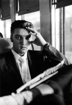 Going Home: Elvis on the Southern Railroad between Chattanooga and Memphis TN. July 4, 1956 (Photo by Alfred Wertheimer)