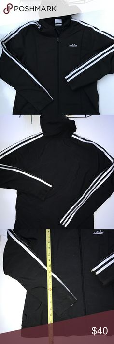Adidas Black and White Jacket Adidas Medium black and white zip Up Jacket with two side pockets, 3 stripes on the sleeves and a hood. Shell 100% Poly and Lining 65% Poly and 35% cotton. adidas Jackets & Coats