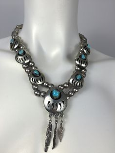 Sterling silver Navajo bear claw necklace with turquoise. Shop prettypennyclothing.com
