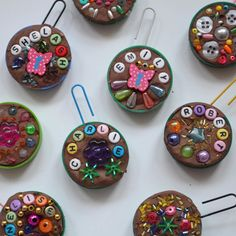'Name Bauble' tree decortions made with plastic milk bottle lids, clay and beads. The hanging hook is a paper clip. This craft idea was very popular at our recent school fair