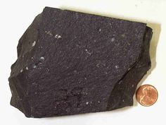 Basalt: extrusive igneous mafic rock; composed mostly of pyroxene, plagioclase feldspar & olivine; ferromagnesian minerals (olivine & pyroxene) are dark-colored minerals that contain a significant amount of iron and/or magnesium; less silicic than pyroclastic material from Mt. St. Helens ex: Hawaiian islands