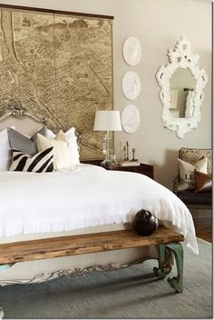 love the vintage bench at the foot of the bed.