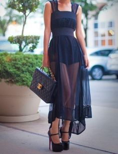 sophisticated sheer black mixi dress. I love this, goes perfectly with the classic quilted Chanel bag
