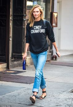 Tribute: Karlie Kloss paid homage to Cindy Crawford by wearing a top that spelled out the original supermodel's name while out and about in NYC on Thursday