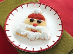 These Santa faced, bell shaped Betty Crocker® Sugar cookies are decorated with coconut, icing, red sparkling sugar and candies - the perfect Christmas dessert for a timeless treat.