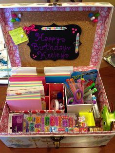 Stationary box for 7 year old girl. Pens, stickers, cards, envelopes, stapler, tape and scissors.
