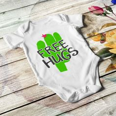 Customized baby bodysuit, unisex, in white, black or pink color with lap shoulders and bottom snaps. Add your baby's name or birth date. Free Hugs, Personalized Baby Gifts, Unisex Baby, Baby Bodysuit, Refashion, Baby Names, Bodysuits, Pink Color, Little Ones