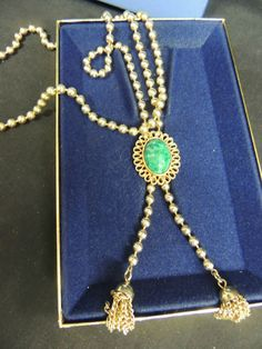 Mouse over image to zoom                                                                                                                                                               Have one to sell? 	Sell it yourself           VTG Designer AVON MIB Necklace Ming Green Gold Jade Tassle Box Bolo Runway Chunky
