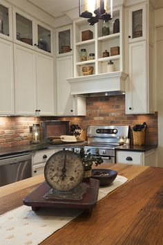 A cozy kitchen with exposed cupboards, a brick backsplash and hardwood tabletops.``