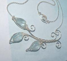 This necklace looks great no matter what stone I use! Elegant in Aquamarine! Blue Aquamarine Leaf Necklace Aquamarine Gemstone by WiredByTara, $70.00