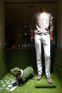 Hermes green spring windows displays Paris   - is the dog mannequin covered in Astro turf?
