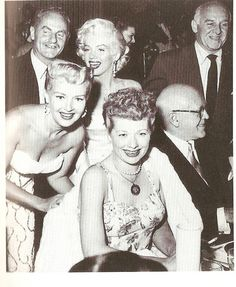 Betty Grable, Lucille Ball, Marilyn Monroe and some gents