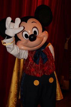 Mickey Mouse is saying rock on in the magic kingdom