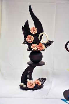 A chocolate showpiece from an ICE Pastry & Baking Arts class with roses. Great use of our Noodles and Leaf Showpeels!