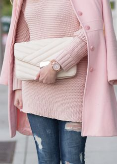 Total blush crush on how All Gussied Up Blog has styled our pink knit sweater with a blush coat and cream clutch. She adds the perfect edge to the look with distressed denim | Banana Republic