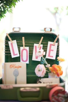love this idea of decorating a suitcase and filling it up with items at a market stall