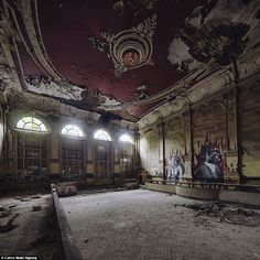 From buildings built by the Nazis to ornate theatres, burnt out hotels and eerie sanatoriums, these are the abandoned buildings that still litter the powerhouse of Europe. Pictured here is an abandoned theatre that has not seen a show for years Read more: http://www.dailymail.co.uk/travel/travel_news/article-2819204