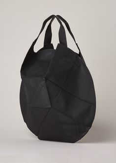 Rounded geometric origami folded bag in black coated leather with a snap closure at top.