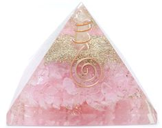 """This particular Pyramid is approximately  2"""" Inches tall and 2"""" Inches wide handcrafted and poured with a crystal clear resin  There is no dirt or yellow or orange tint. Just a pure crystal clear resin mixed tumbled rose quartz along with the typical ingredients such as metal shavings and copper."""