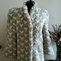 Vintage Faux Fur Coat XS-S Wow! This gorgeous faux fur coat is fully lined in gray satin. Amazing condition!  No size tag, but it fits like an XS-S. No trades. Reasonable offers through the offer button are welcome. Russel Taylor Jackets & Coats