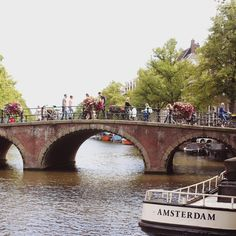 Amsterdam canals and bridges and bikes, always picture perfect - The Travelling Light
