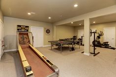 Lower level gaming & work out area. Could be an in-law suite.