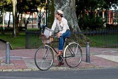 Cycling in Bogota... super stylish, we especially love the hat!