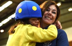 Billy Caldwell shows his  affection for his mother  Charlotte, at the Riding for the Disabled centre in Omagh.