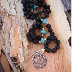tree of life 9.25 silver, lava stone, turquoise removeable heart lock (so you can swap charms to suit your mood) :-) MALA x silk and knotted between each bead x www.lava-links.com