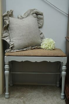 Love the burlap seat and distressed bench combo! Would be cute for covered porch or entry.