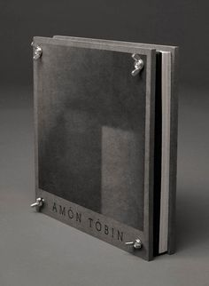 """Designed by Oscar & Ewan, manufactured by Think Tank and released on Ninja Tune, the Amon Tobin deluxe boxset is a strictly limited edition release and comes in the form of a beautiful, high quality, bolt-fastened mechanical 'press'. Packed inside are 6 x 10"" vinyl, 7 x CD, 2 x DVD and several posters. Most of the material is unreleased, almost none of it has ever been available on a physical format before."""