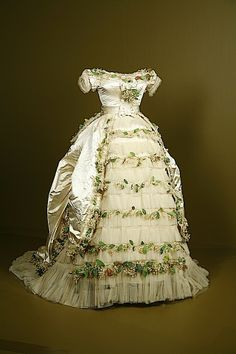 Wedding gown of Elisabeth of Wied, Queen Consort of Romania (Carmen Sylva). The dress is made of silk satin and silk tulle, with cotton and paper faux flowers. (Held at Fashion Institute of Design and Merchandising, Los Angeles. 1800s Fashion, Victorian Fashion, Vintage Fashion, Vintage Gowns, Vintage Outfits, Beautiful Gowns, Beautiful Outfits, Victorian Gown, Retro Mode