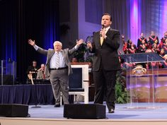 """Raise your hands and lift your voice to shout, """"Hallelujah to the Lamb of God!"""" Our God reigns!"""