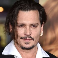 Johnny Depp - Celebrities Who Own Private Islands - Coastal Living