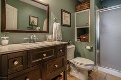 Traditional 3/4 Bathroom with Built-in bookshelf, Undermount Sink, Flush, limestone tile floors, Flat panel cabinets