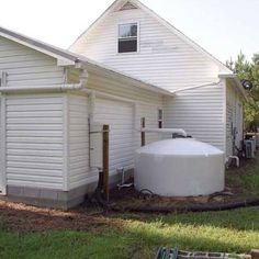 Design a rainwater collection system such as this one by harvesting rainwater to provide water for your home and garden