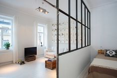 Industrial glass interior windows is a great way to transmit light throughout this small apartment.