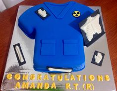 Radiology Technician Cake - This cake was made with a shirt cake pan. It was covered with buttercream and rolled out fondant. The bones and letters were made with chocolate