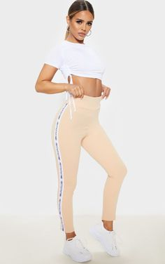 The Prettylittlething Petite Fawn Side Tape Leggings . Head online and shop this season's range of petite at PrettyLittleThing. Petite Jeans, Petite Tops, Printed Trousers, Wide Leg Trousers, Petite Outfits, Petite Dresses, Petite Jumpsuit, Cigarette Trousers, Lace Up Trainers