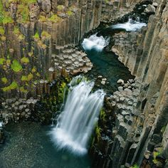 Hexagonal rocks / This is an Icelandic waterfall called Litlanesfoss. The columns form due to stress as the lava cools. The lava contracts as it cools, forming cracks. Once the crack develops it continues to grow. The growth is perpendicular to the surface of the flow. One of the coolest things I have ever seen! http://www.theworldgeography.com/2013/01/basalt-formations.html #geekingout