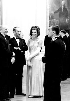 For the State Dinner honoring the Nobel Prize winners of the Western Hemisphere held the White House on April 29, 1962, First Lady Jacqueline Kennedy wore an Oleg Cassini evening dress in celadon silk jersey draped to form a pleated skirt and a gathered bust line.❤❤❤ ❤❤❤❤❤❤❤   http://en.wikipedia.org/wiki/Jacqueline_Kennedy_Onassis