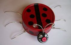 A cute little lady bug for your garden, made from a tuna can! via S.C.R.A.P.
