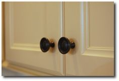 Rubbed bronze hardware on shaker cabinets
